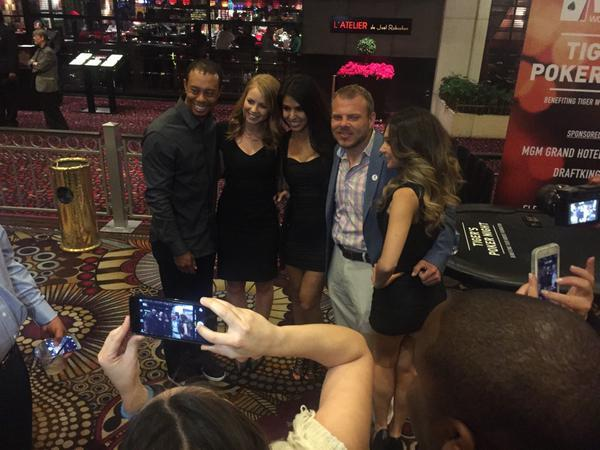 Tiger Woods shows off his bald spot in charity poker tournament.