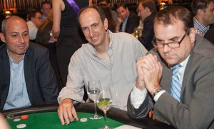 Wall Street investors play poker in Take 'Em to School event.