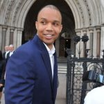 Phil Ivey lost his $10.1 million court battle with the Borgata on Thursday, but at least he gets to keep the comps. Photo shows him outside the Royal Courts of Justice during the Crockfords case, with Kelly Sun in the background. (Image: BBC)