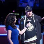 Kara Scott, shown here interviewing Phil Hellmuth during a WSOP broadcast, will be back as a commentator for the 2017 World Series of Poker.  (Image: picssr.com)