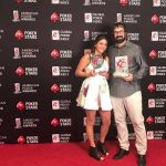 Jason Mercier and wife Natasha hold up trophies he won at Thursday night's 2017 American Poker Awards in Beverly Hills, California. (Image: Twitter)