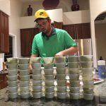 Mike Noori, seen behind a giant wall of guacamole containers, attempted to eat $1,000 of McDonald's food in 36 hours, but didn't even come close. (Image: Twitter)