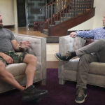 High-stakes poker player Dan Bilzerian (left) sitting down with Graham Bensinger, insisting his money has come through playing high-stakes poker, not from a trust fund. (Image: YouTube)