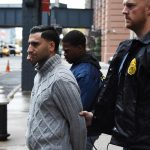 Isok Aronov is escorted out of New York DEA Headquarters after he was busted operating a gambling den on Coney Island. (Image: New York Daily News)