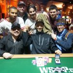 Despite being denied his first ring, poker grinder Jesse Capps (seated far right) congratulated Paul Sokoloff on his victory by jumping into the winner's pic. (Image: WSOP)