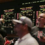 Gamblers examine the odds for NCAA tournament games at the Mirage Race and Sports Book in Las Vegas in 2013. (Image: Julie Jacobson/AP)