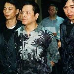 Wan Kuok-koi, seen here being arrested in 1998, is helping to fund a new poker event in China. (Image: South China Morning Post)