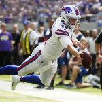 Buffalo Bills quarterback Josh Allen dives for one of his two touchdown runs during Buffalo's 27-6 victory over the Minnesota Vikings in Week 3 of the 2018 NFL season. (Image: AP/Bruce Kluckhorn)