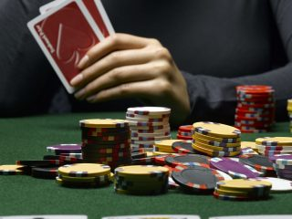 Former Police Officer Pleads Guilty to Covering Up Illegal Wichita Poker Games