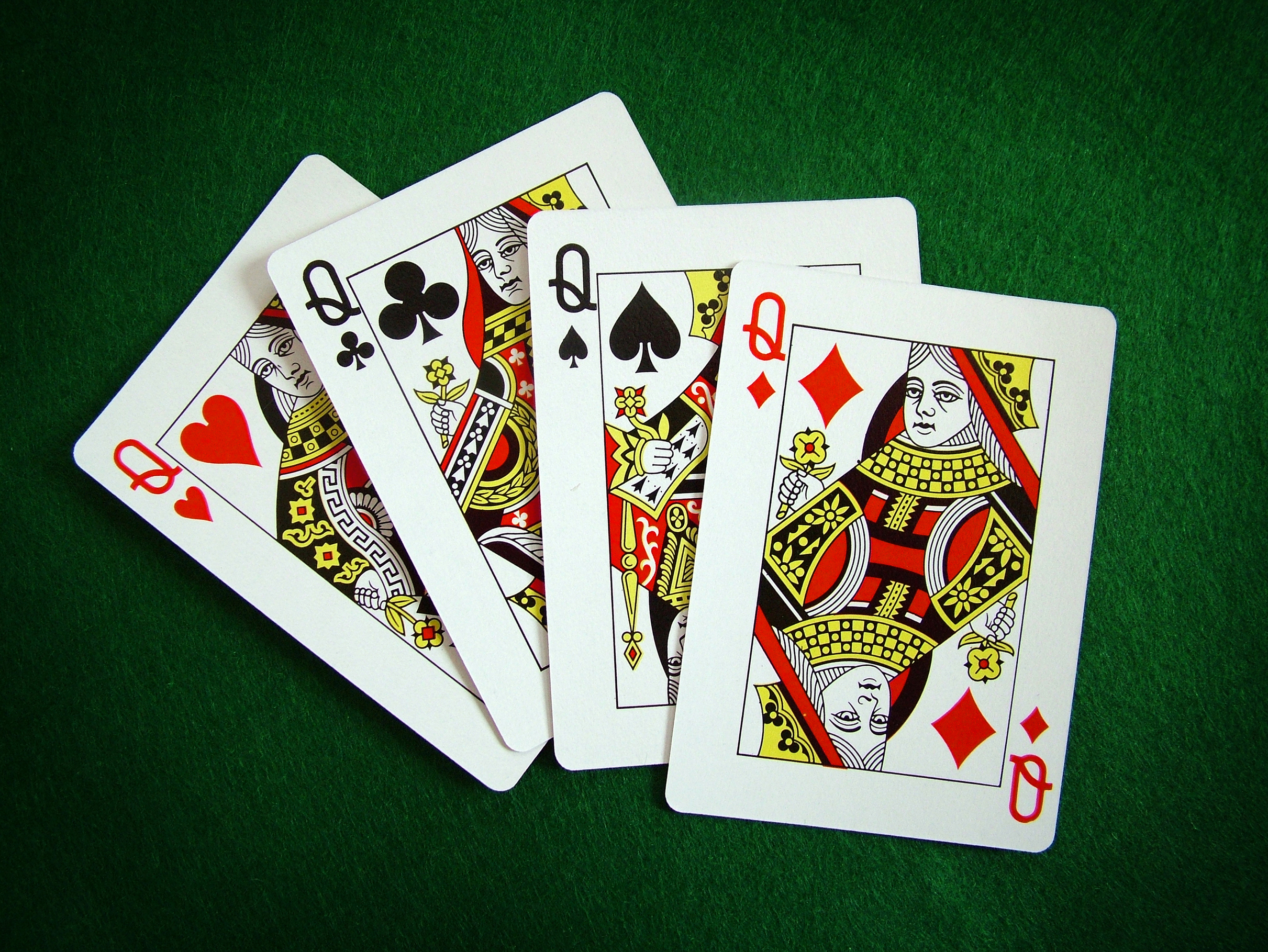 poker players folding quad queens