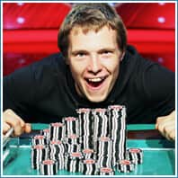 Happy player with big stack of poker chips